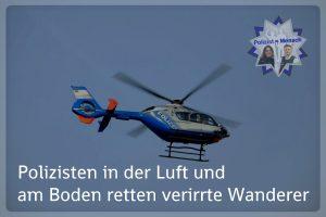 Polizisten in der Luft und am Boden retten verirrte Wanderer
