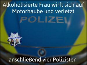 Alkoholisierte Frau wirft sich auf Motorhaube und verletzt anschließend vier Polizisten