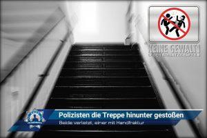 Beide verletzt, einer mit Handfraktur: Polizisten die Treppe hinunter gestoßen