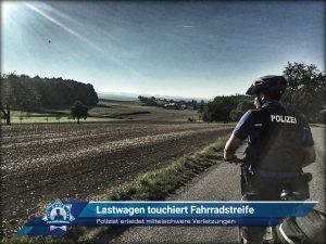 Polizist erleidet mittelschwere Verletzungen: Lastwagen touchiert Fahrradstreife
