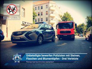 Personenkontrolle eskaliert: Unbeteiligte bewerfen Polizisten mit Steinen, Flaschen und Blumentöpfen - Drei Verletzte