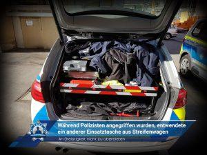 An Dreistigkeit nicht zu überbieten: Während Polizisten angegriffen wurden, entwendete ein anderer Einsatztasche aus Streifenwagen