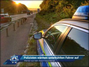 Warten auf den Abschleppdienst: Polizisten wärmen unterkühlten Fahrer auf