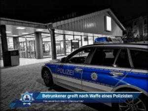Hausverbot beim Discounter: Betrunkener greift nach Waffe eines Polizisten